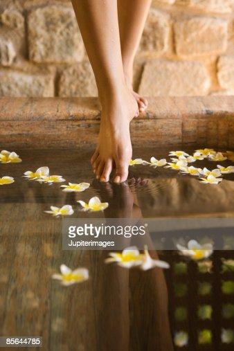 Feet with plumeria flowers
