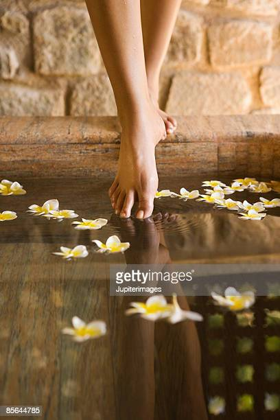 Feet with plumeria flowers