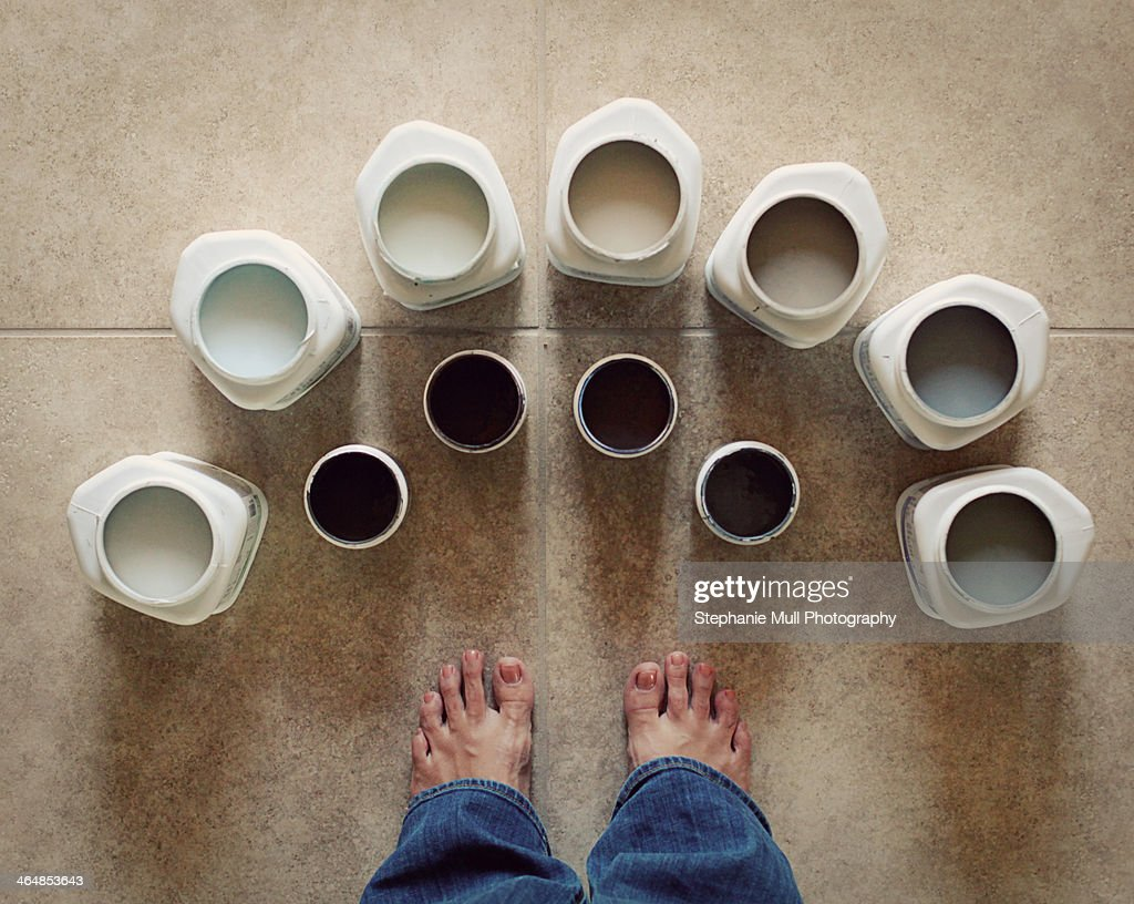 Feet with Sample Cans of Paint : Stock Photo