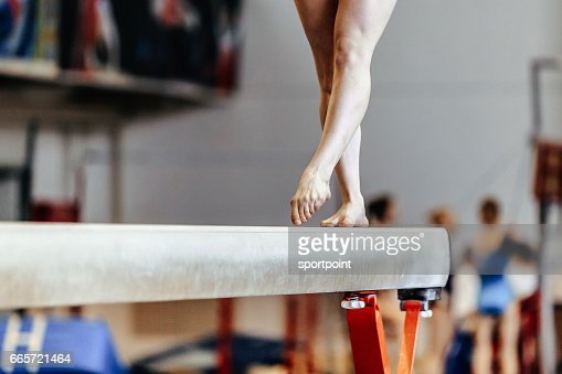 feet woman gymnast exercises on balance beam competition in artistic gymnastics : Stock Photo