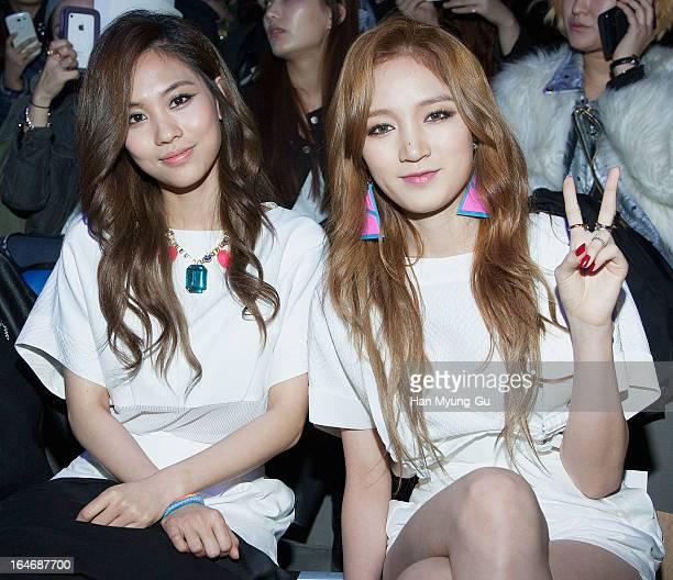 Fei and Jia of South Korean girl group Miss A attend during at the 'KAAL E SUKTAE' show on day two of the Seoul Fashion Week F/W 2013 at IFC Seoul on...