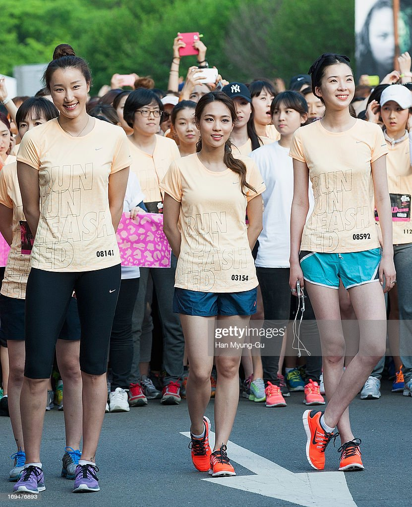 Fei (C) of girl group Miss A attends a promotional event for the 'Nike She Runs Seoul 7K' on May 25, 2013 in Seoul, South Korea.