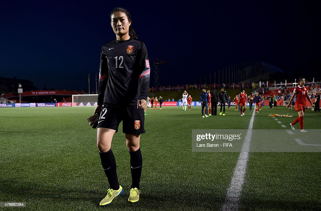 Fei Wang of China looks dejected after loosing the FIFA Women's World Cup 2015 Quarter Final match between China and United States at Lansdowne...