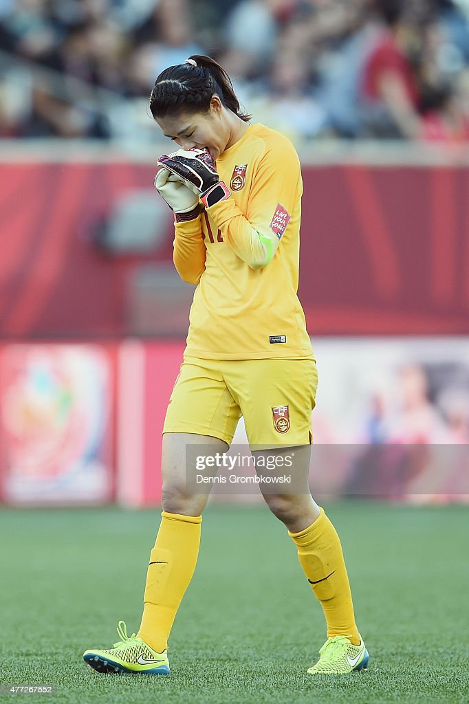 Fei Wang of China PR reacts during the FIFA Women's World Cup Canada 2015 Group A match between China PR and New Zealand at Winnipeg Stadium on June...