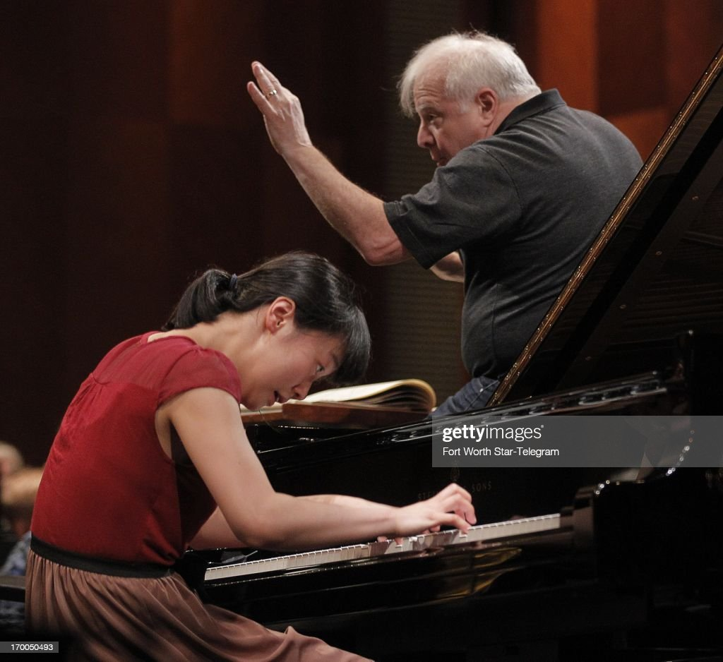 Fei-Fei Dong, of China, age 22, rehearses with the Fort Worth Symphony Orchestra under the direction Leonard Slatkin, right, on the first day of the final round of the 14th Van Cliburn International Piano Competition, in the Bass Performance Hall, Thursday, June 6, 2013.