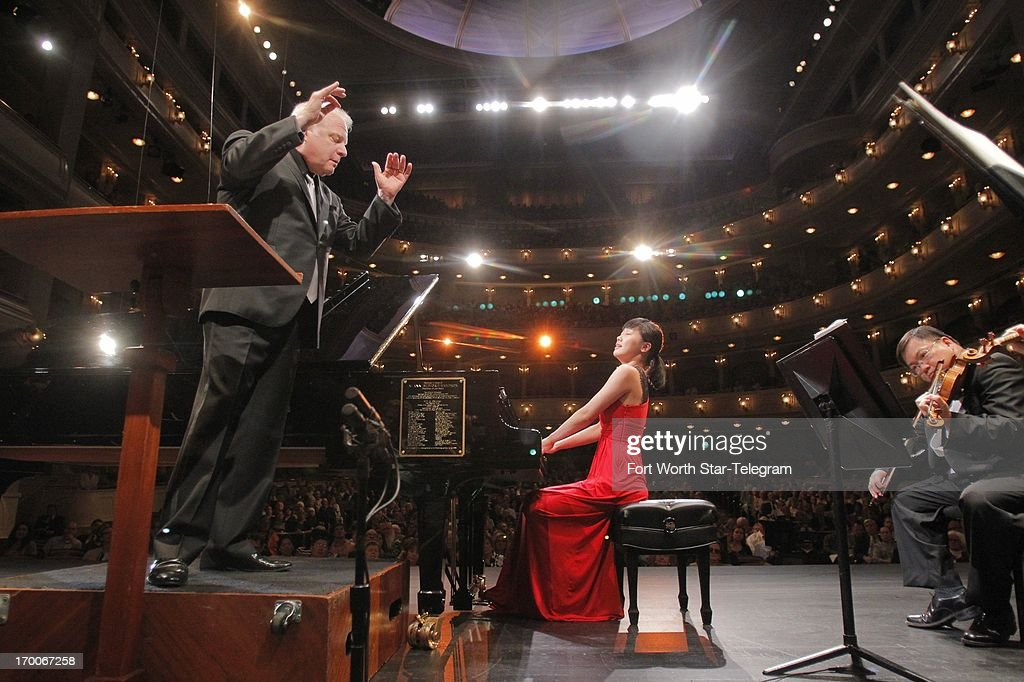 Fei-Fei Dong, of China, performs with Maestro Leonard Slatkin during the 14th Van Cliburn International Piano Competition in Fort Worth, Texas on Thursday, June 6, 2013.