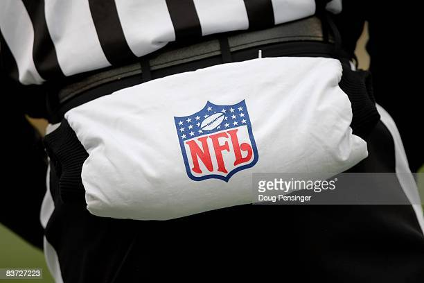 Feild Judge Gary Cavaletto sports a hand warmer to protect against the elements as the Chicago Bears face the Green Bay Packers during NFL action at...
