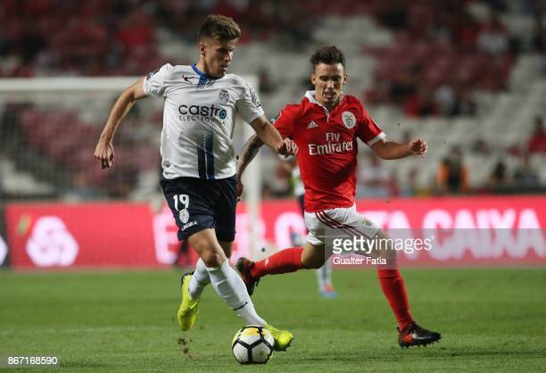 Feirense forward Joao Silva from Portugal with SL Benfica defender Alejandro Grimaldo from Spain in action during the Primeira Liga match between SL...