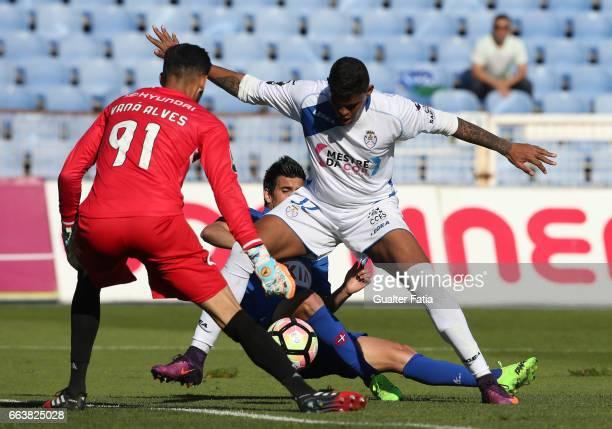 Feirense's defender Flavio Ramos from Brasil with Belenenses's forward Miguel Rosa from Portugal and Feirense's goalkeeper Vana Alves from Brasil in...