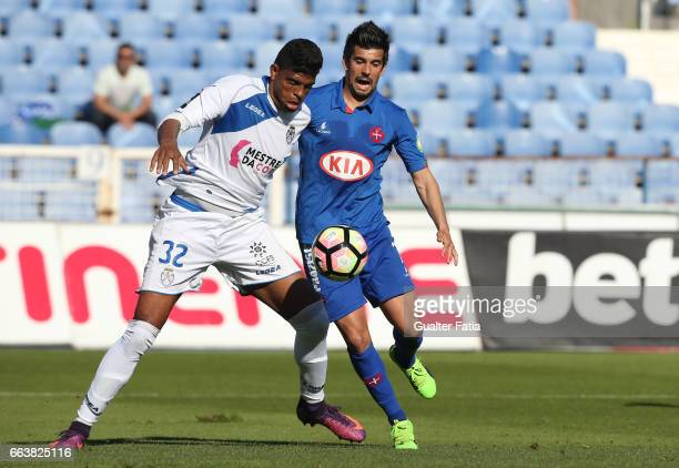 Feirense's defender Flavio Ramos from Brasil with Belenenses's forward Miguel Rosa from Portugal in action during the Primeira Liga match between CF...