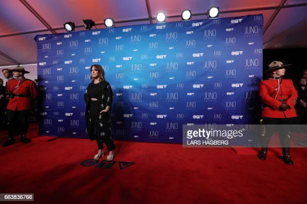 Feist arrives on the red carpet before the JUNO awards at the Canadian Tire Centre in Ottawa Ontario on April 2 2017 / AFP PHOTO / Lars Hagberg