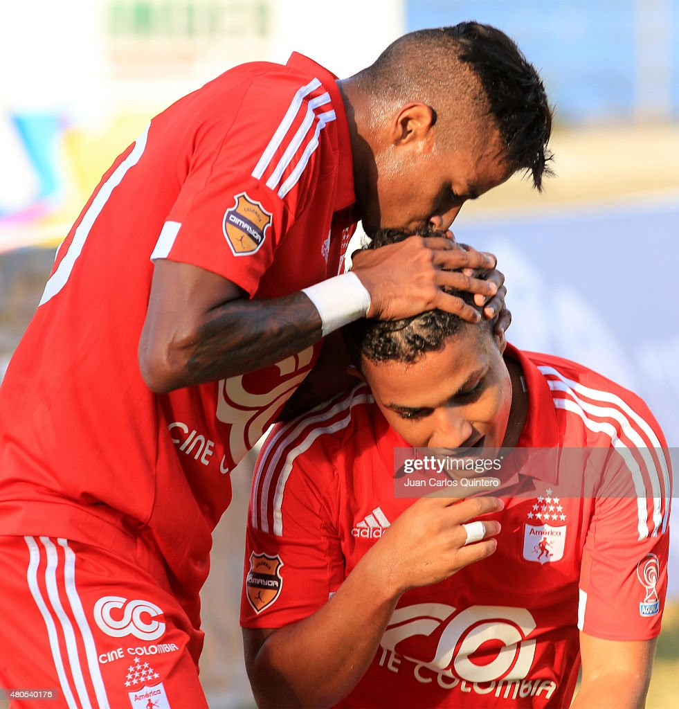 Feiver Mercado of America de Cali celebrates with his teammate after scoring the third goal of his team during a match between America de Cali and Bogota FC as part of 17th round of Torneo Aguila 2015 at 12 de Octubre Stadium on July 12, 2015 in Tulua, Colombia.
