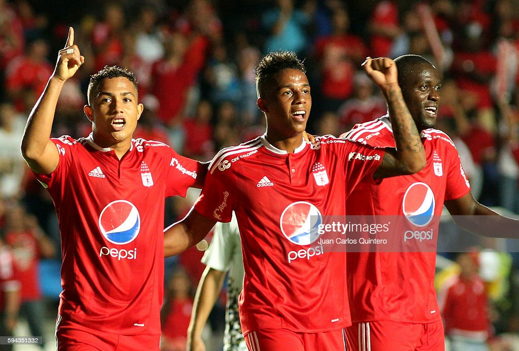 Feiver Mercado of America de Cali celebrates with teammates after scoring the fourth goal of his team during a match between America de Cali and...