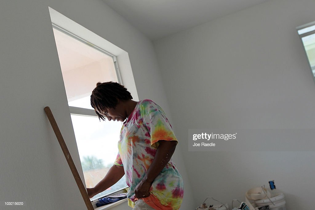 Felecia Almy works on a window frame as she helps build a Habitat for Humanity home on August 3, 2010 in Fort Lauderdale, Florida. In July, Habitat for Humanity was named the eighth largest homebuilder in the United States by Builder's Magazine, the first time the nonprofit has been among the top 10 biggest builders in the United States.