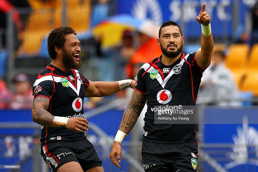 Feleti Mateo of the Warriors celebrates his try with Manu Vatuvei during the round eight NRL match between the New Zealand Warriors and the Gold Coast Titans at Mt Smart Stadium on May 5, 2013 in Auckland, New Zealand.