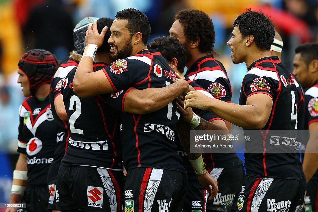 Feleti Mateo of the Warriors celebrates his try with the team during the round eight NRL match between the New Zealand Warriors and the Gold Coast Titans at Mt Smart Stadium on May 5, 2013 in Auckland, New Zealand.