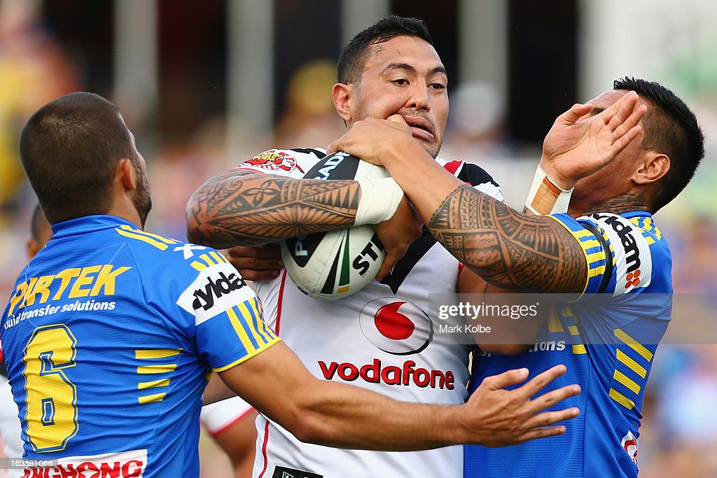 Feleti Mateo of the Warriors is tackled during the round one NRL match between the Parramatta Eels and the Warriors at Parramatta Stadium on March 9, 2013 in Sydney, Australia.