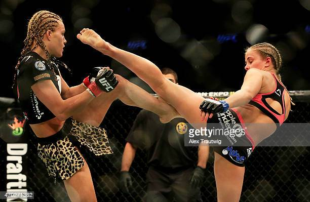 Felice Herrig and Paige VanZant exchange kicks in their women's strawweight bout during the UFC Fight Night event at Prudential Center on April 18...