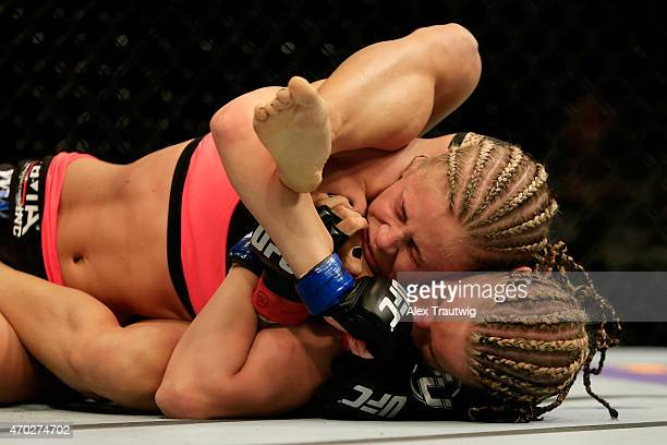 Felice Herrig and Paige VanZant grapple in their women's strawweight bout during the UFC Fight Night event at Prudential Center on April 18 2015 in...