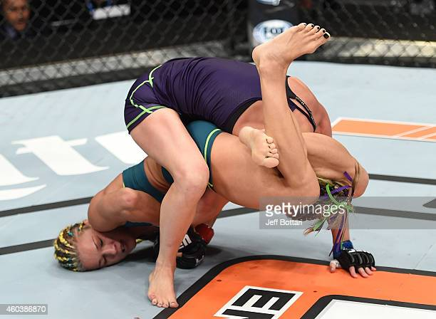 Felice Herrig attempts to submit Lisa Ellis in their strawweight fight during The Ultimate Fighter Finale event inside the Pearl concert theater at...