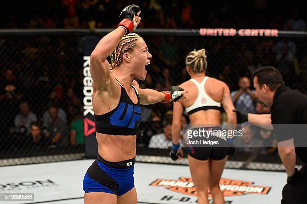 Felice Herrig celebrates after defeating Kailin Curran by submission in their women's strawweight bout during the UFC Fight Night event at the United...