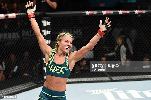 Felice Herrig celebrates her submission victory over Lisa Ellis in their strawweight fight during The Ultimate Fighter Finale event inside the Pearl...
