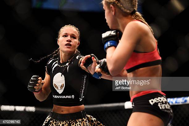 Felice Herrig exchanges blows with Paige VanZant in their women's strawweight bout during the UFC Fight Night event at Prudential Center on April 18...
