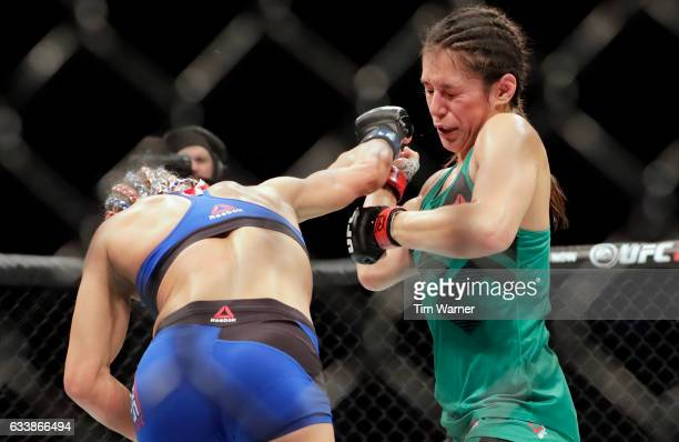 Felice Herrig hits Alexa Grasso of Mexico with a right in the second round on February 4 2017 in Houston Texas