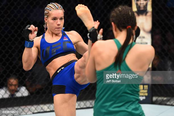 Felice Herrig kicks Alexa Grasso of Mexico in their women's strawweight bout during the UFC Fight Night event at the Toyota Center on February 4 2017...