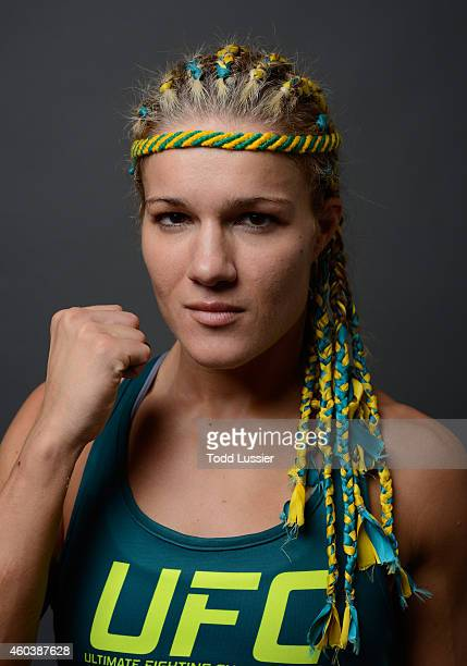 Felice Herrig poses for a postfight portrait backstage during The Ultimate Fighter Finale event inside the Pearl concert theater at the Palms Casino...