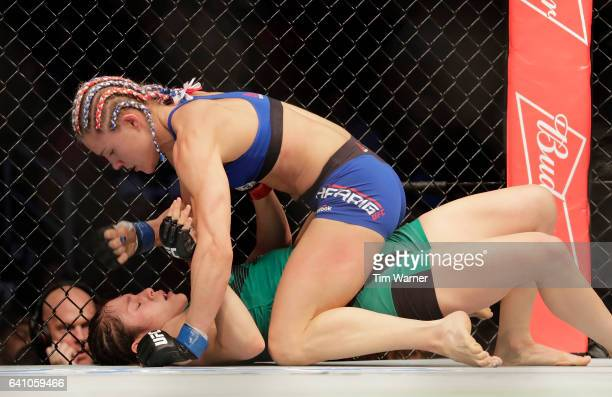 Felice Herrig punches Alexa Grasso in the Women's Strawweight Bout during UFC Fight Night at the Toyota Center on February 4 2017 in Houston Texas