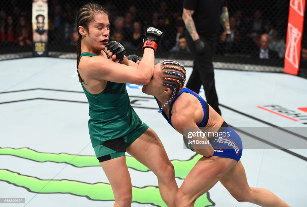 Felice Herrig punches Alexa Grasso of Mexico in their women's strawweight bout during the UFC Fight Night event at the Toyota Center on February 4, 2017 in Houston, Texas.