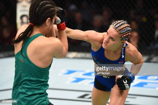 Felice Herrig punches Alexa Grasso of Mexico in their women's strawweight bout during the UFC Fight Night event at the Toyota Center on February 4...