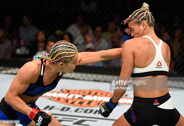 Felice Herrig punches Kailin Curran in their women's strawweight bout during the UFC Fight Night event at the United Center on July 23 2016 in...