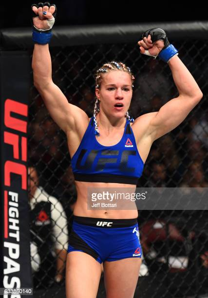 Felice Herrig raises her hands after facing Alexa Grasso of Mexico in their women's strawweight bout during the UFC Fight Night event at the Toyota...