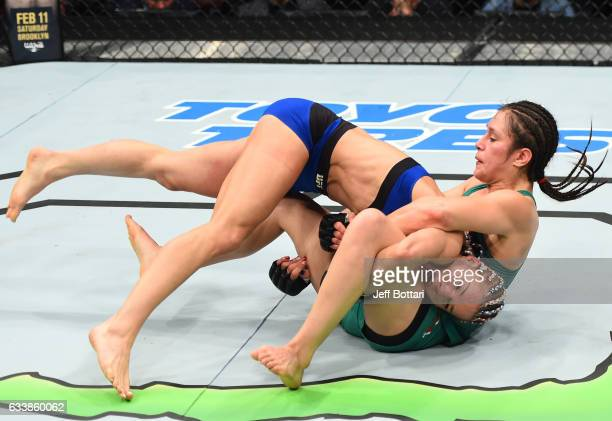 Felice Herrig takes down Alexa Grasso of Mexico in their women's strawweight bout during the UFC Fight Night event at the Toyota Center on February 4...