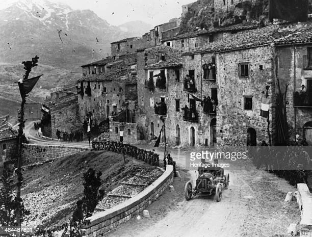 Felice Nazzaro driving through Pettralia Sottana in a Fiat in the Targa Florio race Sicily 1907 Nazzaro was to come first in this race He won a...