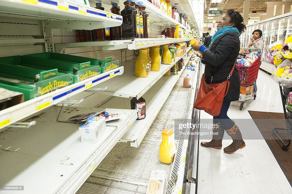 Felicia Adjei, 29, and Onique Willis, hunt for bargains on the nearly empty store shelves at Magruders Tuesday, January 15, 2013 in Gaithersburg, MD.