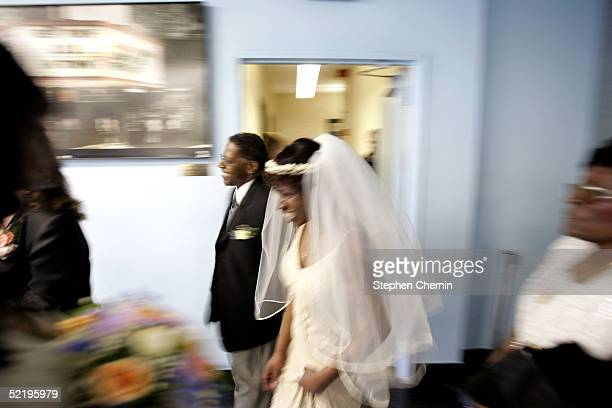 Felicia and Gary Foster who have been married 19 years walk toward the altar to renew their vows at the Empire State Building Sky Lobby February 14...