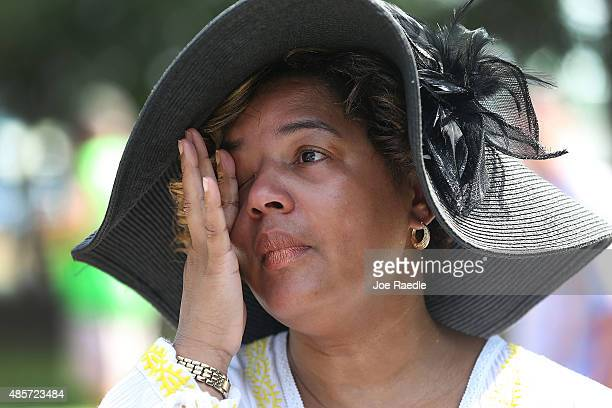 Felicia Covin wipes her eyes as she becomes emotional while attending a 10th anniversary of Hurricane Katrina event at the New Orleans Katrina...