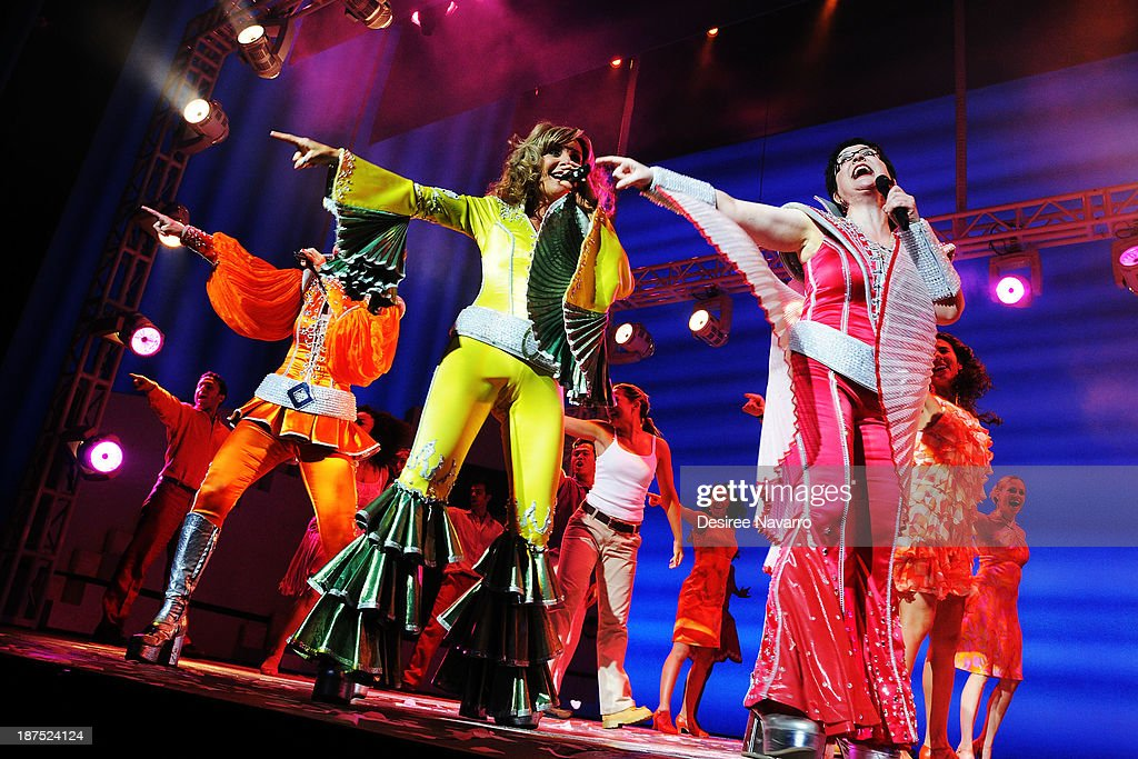 Felicia Finley, Judy McLane and Lauren Cohn perform on stage during curtain call at the 5,000 performance celebration of 'Mamma Mia!' on Broadway at Broadhurst Theatre on November 9, 2013 in New York City.