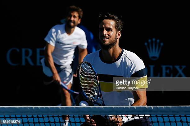 Feliciano Lopez and Marc Lopez of Spain compete in their first round match against Alexandr Dolgopolov of the Ukraine and Gerald Melzer of Austria on...