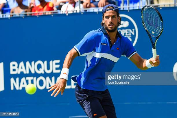 Feliciano Lopez makes eye contact with the ball returns the bal during his first round match at ATP Coupe Rogers on August 8 at Uniprix Stadium in...