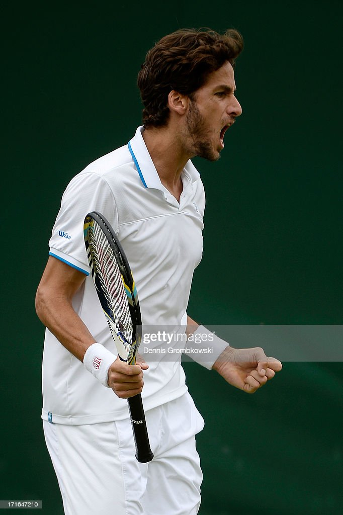 Feliciano Lopez of Spain celebrates a point during his Gentlemen's Singles second round match against Paul-Henri Mathieu of France on day four of the Wimbledon Lawn Tennis Championships at the All England Lawn Tennis and Croquet Club on June 27, 2013 in London, England.