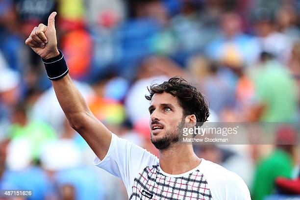 Feliciano Lopez of Spain celebrates after defeating Fabio Fognini of Italy during their Men's Singles Fourth Round match on Day Seven of the 2015 US...