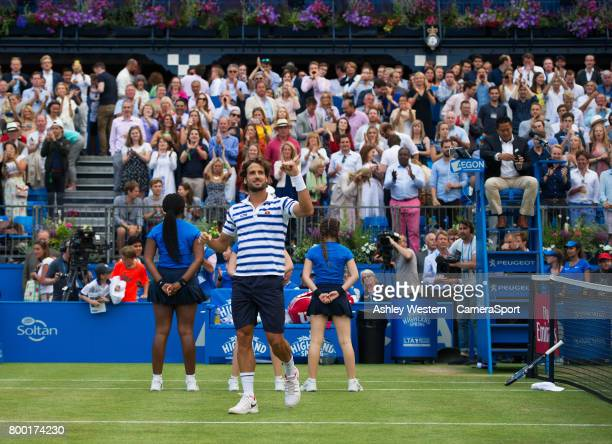 Feliciano Lopez of Spain celebrates his victory against Tomas Berdych of The Czech Republic in their Men's Singles Quarter Final Match during Day 5...