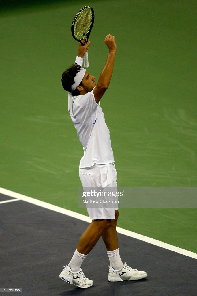 Feliciano Lopez of Spain celebrates match point against Guillermo Garcia-Lopez of Spain during day one of the 2009 Shanghai ATP Masters 1000 at Qi Zhong Tennis Centre on October 11, 2009 in