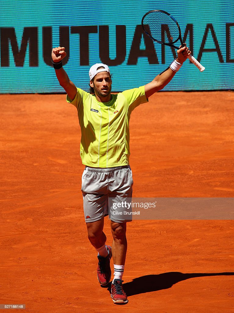 <a gi-track='captionPersonalityLinkClicked' href=/galleries/search?phrase=Feliciano+Lopez&family=editorial&specificpeople=206172 ng-click='$event.stopPropagation()'>Feliciano Lopez</a> of Spain celebrates match point against Leonardo Mayer of Argentina in their first round match during day three of the Mutua Madrid Open tennis tournament at the Caja Magica on May 02, 2016 in Madrid,Spain.