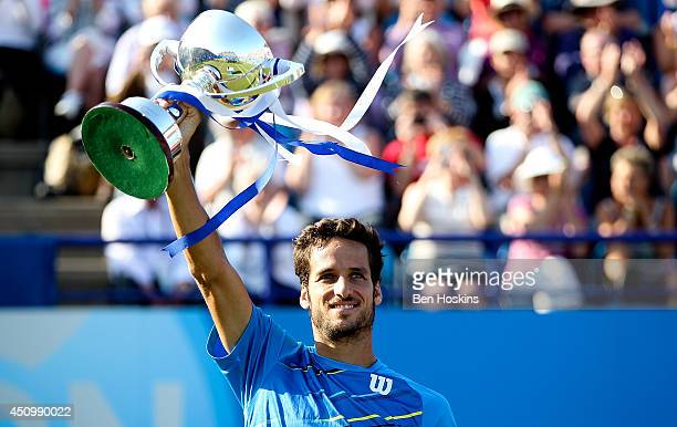 Feliciano Lopez of Spain celebrates with the trophy after winning the Men's Final between Richard Gasquet of France and Feliciano Lopez of Spain at...
