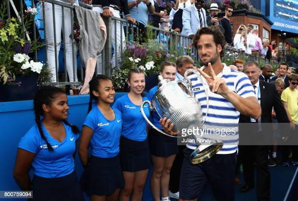 Feliciano Lopez of Spain celebrates with the winners trophy following victory in the mens singles final against Marin Cilic of Croatia during day...